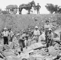 Photo of internees and guards at a road construction